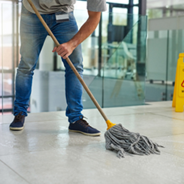 Man from one of the best cleaning companies in Peoria IL mopping floor