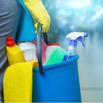 Maintenance Worker holding bucket of cleaning supplies for commercial cleaning in Peoria IL