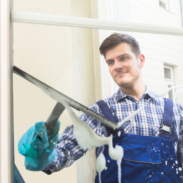 Man cleaning window as part of Office Cleaning Service in Peoria IL