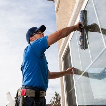 Cleaning company employee in Peoria IL cleaning outer windows