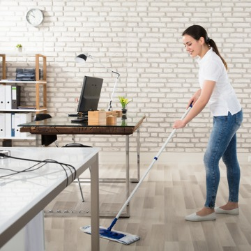 Woman cleaning floor, providing Cleaning Services in Pekin IL